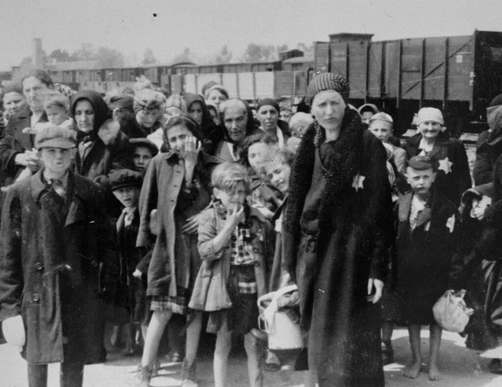 Photo: Bernhardt Walter/Ernst Hofmann. Jewish women and children from Subcarpathian Rus await selection on the ramp at Auschwitz-Birkenau. 1944. USHMM.