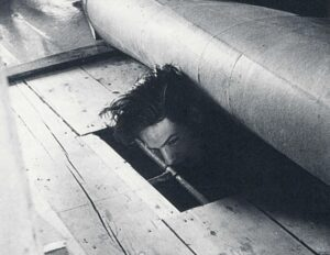 A friend of the photographer hides under the floor in his house. 1944