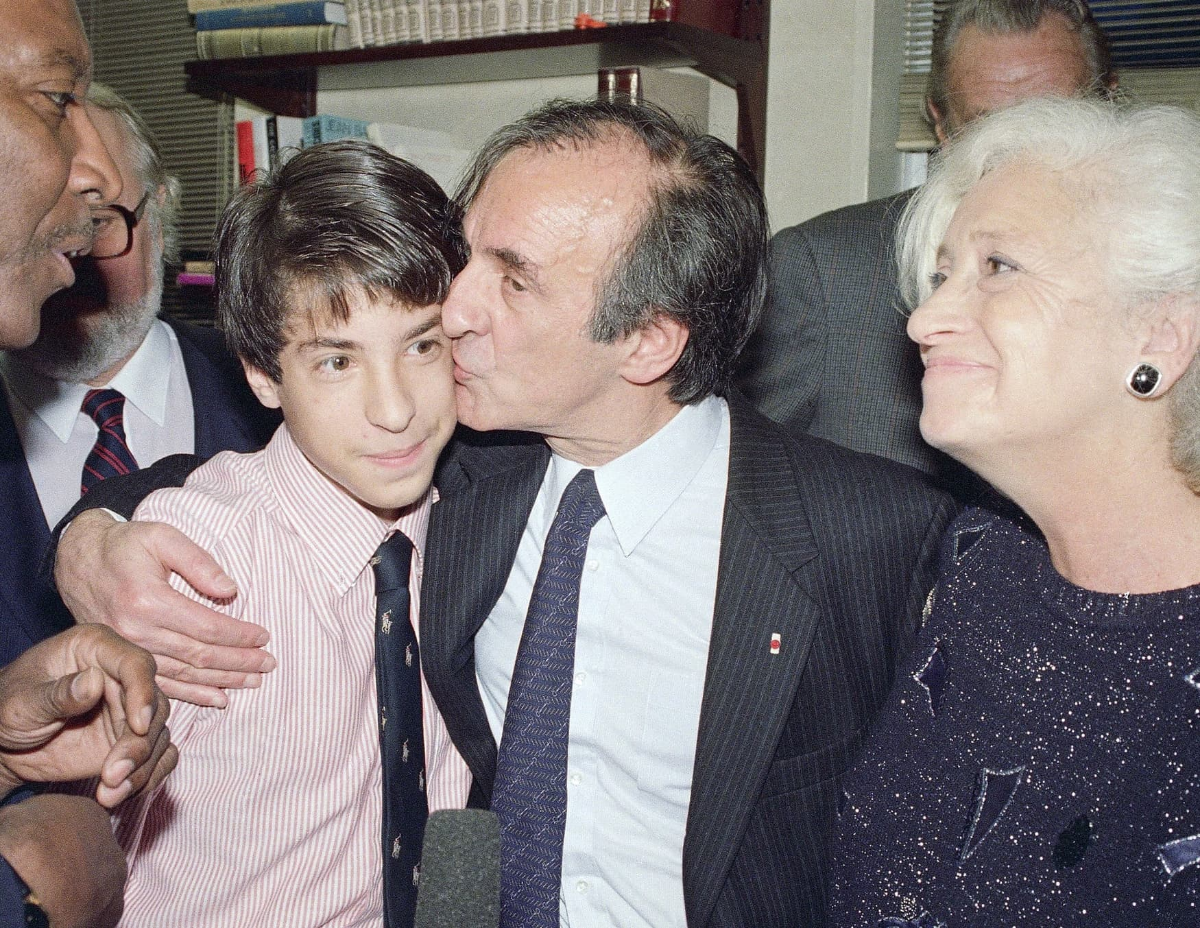 Elie Wiesel, with his wife, Marion, and son, Elisha, in New York after the announcement that he been awarded the 1986 Nobel Peace Prize.Credit...Richard Drew/Associated Press